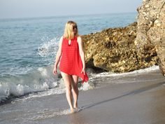 Red and White Striped Swimsuit, A Large Floppy Hat and A Nautical Raffia Beach Bag.