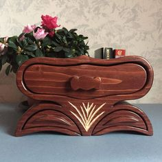 Unique gift for mother from son, handcarved bandsaw box, anniversary gift, keepsake box, jewelry organizer, unique home decor, gift for wife This wooden jewelry organizer is the first of our collection with three drawers and four compartments. It is perfect for keeping your different