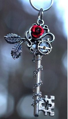Steampunk Rose pendant. Check out http://www.designyourownperfume.co.uk to…