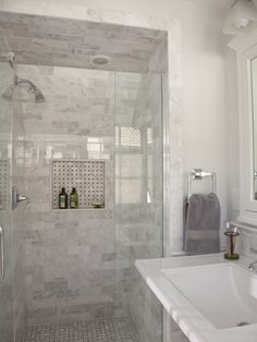 This is the shower stall reno in the Carrera Marble bath
