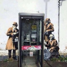 New Banksy street art showing government agents spying on a phone box appears on side of Cheltenham house near to GCHQ.