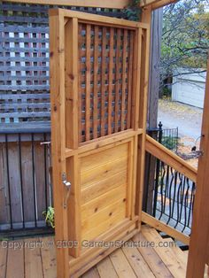 Red cedar gate/door along with a matching fence help turn this formerly plain deck into a private oasis.
