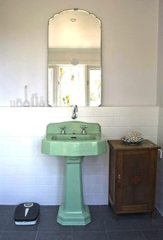 Retro jadeite green pedestal sink, vintage mirror.   #bathroom #sink #pedestal #mirror #green #mint #jadeite #white #retro #vintage