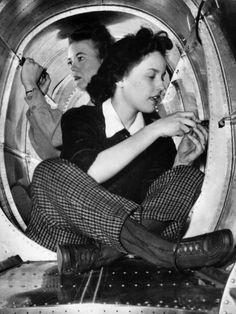 Production aides Ruby Reed and Merle Judd work in cramped quarters at Grumman Aircraft during World War II.