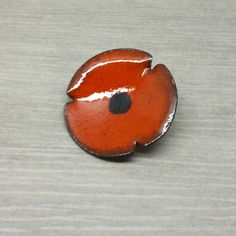 Check out this item in my Etsy shop https://www.etsy.com/uk/listing/253713577/burnt-orange-enamel-flower-brooch-pin