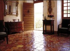 Terra Cotta Tiles - a warm and beautiful European effect...cream walls with mix of wood accents, yum...