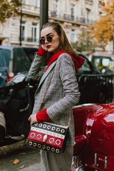 Zara check printed blazer, mango high waisted check print trousers, nakd red hoodie, pfw street style andreea birsan, couturezilla, gucci red leather marmomnt mid heel pumps, cavalli class red white and black striped eyelet shoulder bag, cute fall outfit ideas 2017, the popular zara checked blazer, leather bag, statement bag, how to wear a hoodie with a suit, how to wear a hoodie and look polished, grey and red outfit, ray ban round sunglasses, how to wear double check prints, pfw street…