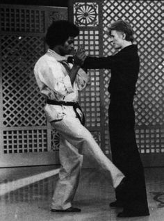 Bowie and Dwain Vaughns demonstrating self defence on Dinah Shore show, February…
