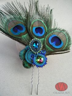 Hair clip with peacock feathers.