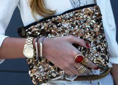 sequin clutch, gold watch, rings
