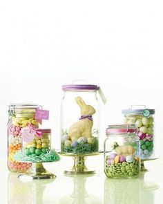 "Easter Candy Parade  Fill glass jars with colorful layers of bulk candy for quick and festive centerpieces. Or, create an Easter basket effect by nestling a white-chocolate bunny or lamb in green paper ""grass."" Finish with ribbon and a tag, or attach a note to the lid using double-sided tape."