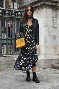 London Fashion Week Street Style | Parisian jewelry designer Anissa Kermiche layered a classic black choker with one of her delicate geometric necklaces. Her floral maxi, leather jacket and Dr. Martens place her clearly in the glam-grunge camp of the style spectrum.