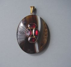 """VICTORIAN Scottish banded agate and garnets pendant, 1-3/4"""" by 1-1/3""""."""