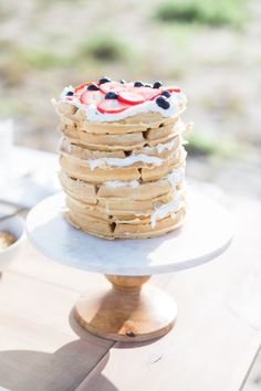 A waffle cake is perfect for a laid-back sunrise elopement! http://www.stylemepretty.com/florida-weddings/2015/09/28/seaside-sunrise-boho-elopement | Photography: Hunter Ryan Photo - http://hunterryanphoto.com/