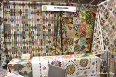 HOLY COW!! loook at these intricate colorful quilts!!! Spring Quilt Market 2015: Sunday - Fat Quarter Shop's Jolly Jabber