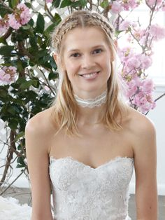 Wrap half-up Dutch braids down a middle part for a wedding hairstyle suitable to short hair.