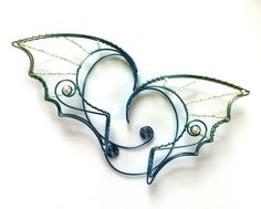 Hypoallergenic niobium dragon ears with pearls by Belethil on Etsy, $85.00