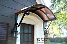 Front door overhang brackets arched wrought iron door for Mobilia vaughan
