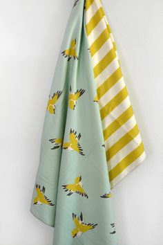 I'm not going to spend $46 on a swaddling blanket, but these are adorable. Organic Birds Swaddle Blanket and Burp Cloth by WrenandRumor.