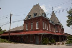 Abandoned Mississippi Central Railroad Depot Holly Springs, MS. Built in 1856 and partially destroyed by fire during the Civil War (Van Dorn raid) the front was rebuilt in 1865. In 1886 it was remodeled to include 20 bedrooms and a 125 seat dining area