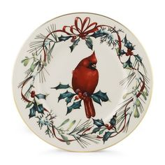 One of the most beloved garden birds, a holiday-bright cardinal, graces the heart of this plate. Created to complement the Winter Greetings dinnerware collection, the plate is crafted of fine china, meticulously hand painted, and rimmed in precious gold. Mix and match with the other accent plates in the collection.