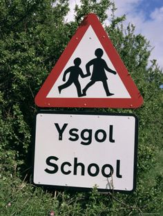 ~ Wales is bilingual ~ road signs are in Welsh and English ~ ARAF (slow) is painted on the curvy hilly roads and it was the first word we learned ~ so excited to learn Welsh ~