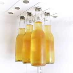 These strong magnetic strips will secure a six pack to the ceiling of the fridge, making for easy access to your favorite brew! #LifeHack