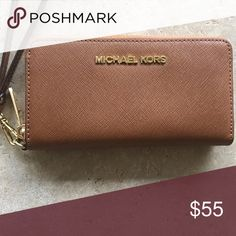 Michael Kors Clutch/Wallet This wallet/clutch goes with anything! And is authentic Michael Kors :) Add this beauty to your purse/ clutch collection. It has literally been taken out twice. Looks brand spanking new!!  Fabulous:)) KORS Michael Kors Bags Clutches & Wristlets