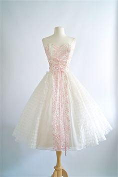 Vintage 1950's strapless prom dress with pink embroidery. #vintagedress #1950sdress #vintage