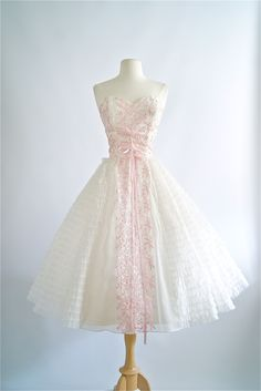 Vintage 1950's strapless prom dress with pink embroidery. #vintagedress #1950sdress #vintage