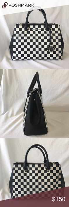 💖Michael Kors Black/White checked purse💖 This purse is an eye catcher with the black/white checked pattern..GREAT condition..(only a few scuffs on MK silver logo on front, you really have to look close to notice) kept in closet only used a few times..gets compliments EVERY time I've used it..buttons on both sides to keep the top opening smaller..zippers on top of both sides with huge compartment space!! Michael Kors Bags Satchels
