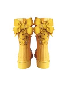 Maggie and I are thinking about how to make these: get some cheap rubber boots, get a tool that puts metal grommets in (at fabric store), put two rows of them down the back of the boots, and lace up the cutest ribbons you can find.  Will. Find. A. Way!!!