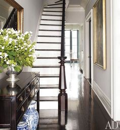 Fresh feeling narrow stairs in the hallway. I have always loved white stairs with dark wood trim, and it looks great in this space with the dark floors and light flooding in.