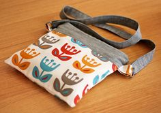 cross-body zippered pouch - love it!  And also, she mentions a Weekend Travel bag her mom made from an Amy Butler pattern...LOVE IT as well!