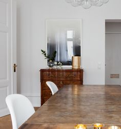 Home with clean lines and two antique cabinets - via cocolapinedesign.com