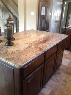Typhoon Bordeaux granite.  Paul really likes this one.   The slab we saw was a bit splashier than this.   It had some big swirls of gray.  We don't have any gray in the kitchen.   We have taupe swirls in the tile but not grey.    I do like the burgundy swirls.  ?? How would I tie in grey