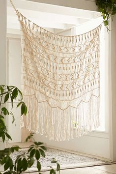 Find something like this for a backdrop ... Magical Thinking Kushi Macrame Wall Hanging - Urban Outfitters