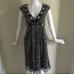 Nanette Lepore Lace Overlay Beaded neckline dress In perfect condition lace overlay dress with a beautiful beaded neckline.   In perfect condition! Nanette Lepore Dresses Midi