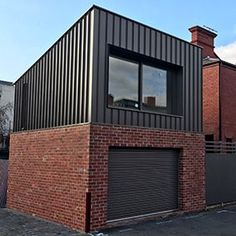 Aluminium cladding, Corten A steel, copper and zinc cladding, metal sheet cladding, supply and install in Melbourne Brick Cladding, House Cladding, Facade House, Cladding Ideas, Architecture Metal, External Cladding, Black House Exterior, Garage Extension, Metal Buildings