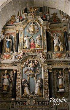 The retablo of Saint Thégonnec in Brittany      It depicts Christ surrounded by angels, receiving the souls that the prayers of St. Dominic and St. Catherine of Siena have delivered from the flames of purgatory.
