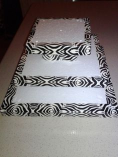 cake/breakfast pop stand. Made out of styrofoam from the dollar store and zebra print duct tape! $12.00 total