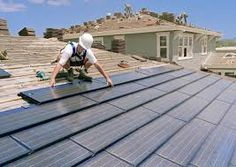 Solar panel roof tiles - a much better idea than the ugly big panels that sit on top of existing roof tiles!