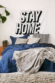 This wall tapestry that belongs right above your bed. | 22 Products People Who Really Love Their Beds Need In Their Lives