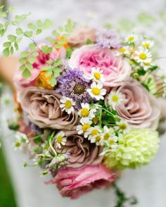 Inspired by the colors of Dwight's bow tie, Sandy's bouquet consisted of roses, ranunculus, chamomile, scabiosa, and zinnias.