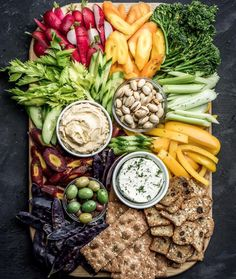 Crudité Platter With Hummus, Olives, Cheese Spread And Crackers by A crudité platter doesn't have to be boring. Add flair by having a variety of dips and colorful veggies! Wine Recipes, Vegan Recipes, Cooking Recipes, Food Platters, Cheese Platters, Cheese And Cracker Tray, Hummus Platter, Crudite Platter Ideas, Clean Eating Recipes