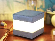 This concrete LED light cube is very simply, yet pretty striking and I think it would make the perfect accent or night light.
