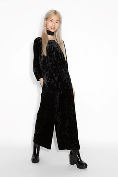 A dream made real, this crushed velvet jumpsuit has wide legs and an open V back.