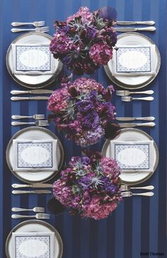 Navy table setting with purple floral. Very simple for us to do and matches the colors well.
