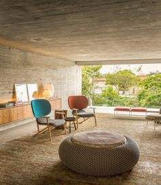 Studio MK27 designed this exposed concrete and wood home in São Paulo to intentionally blur the distinctions between indoors and outdoors. The open plan living room allows for flexibility in furniture configurations, while the raw building materials are intended to evolve and accrue patina over time.