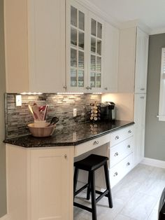 My beautiful kitchen renovation with Allen Roth Shimmering Lights glass backsplash (from Lowes), white cabinets, and butterfly black granite countertops. I love the desk area!